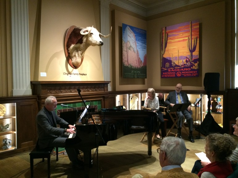 Alan Jones plays the piano while Cindy Miller and Michael Lasser look on. Photo courtesy of Kristen Mancillas