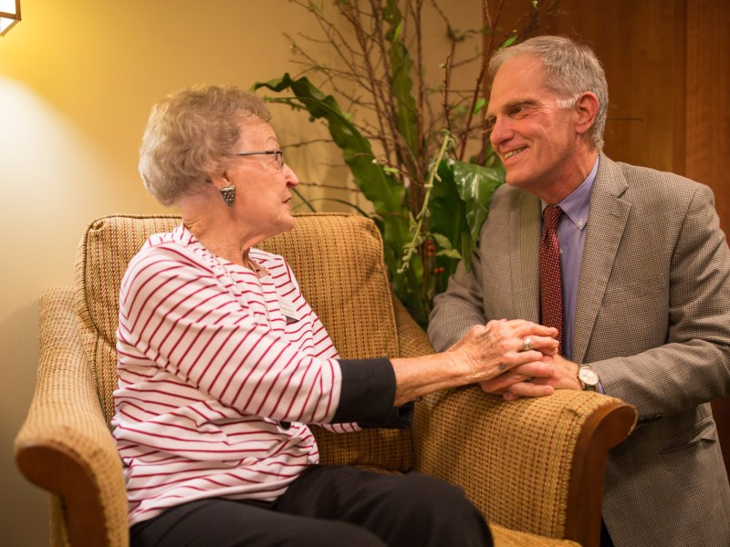 Outgoing President and CEO of Morningside Ministries Alvin Loewenberg visits with six year resident of The Meadows Norma Whitt.