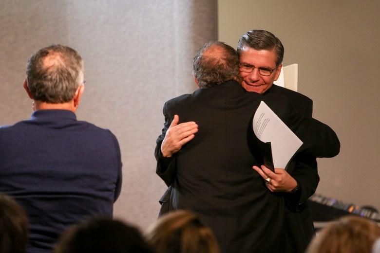 Archbishop of San Antonio Gustavo García-Siller gives Auxiliary Bishop-elect Michael Joseph Boulette a congratulatory hug following his introduction.