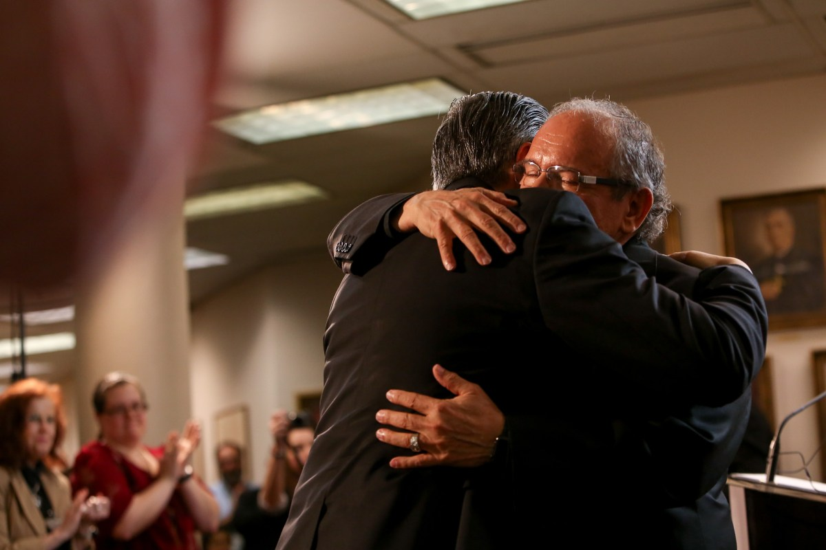 Archbishop of San Antonio Gustavo García-Siller and Auxiliary Bishop-elect Michael Joseph Boulette embrace following the announcement.
