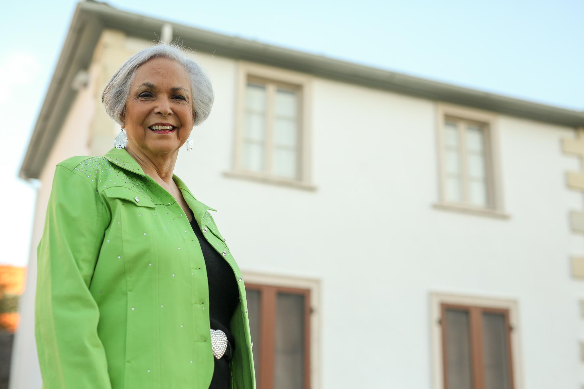 Sylvia Navarro Tillotson stands in front of Casa Navarro for a portrait.