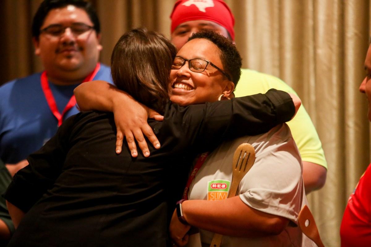 2017 H-E-B Slimdown Showdown contestant Ashley Johnson hugs H-E-B Culinary Nutritionist Charlotte Samuel during her graduation ceremony.