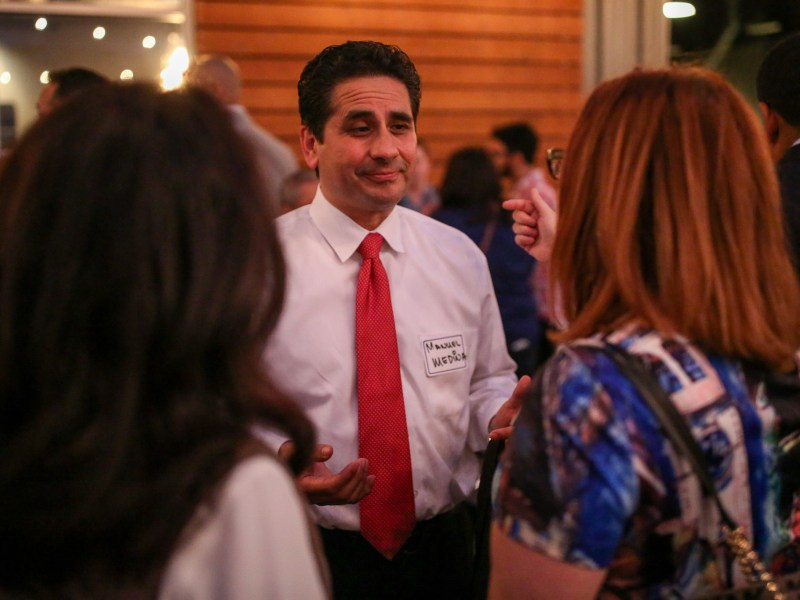 Bexar County Democratic Chair and Mayoral candidate Manuel Medina talks with guests during the event.