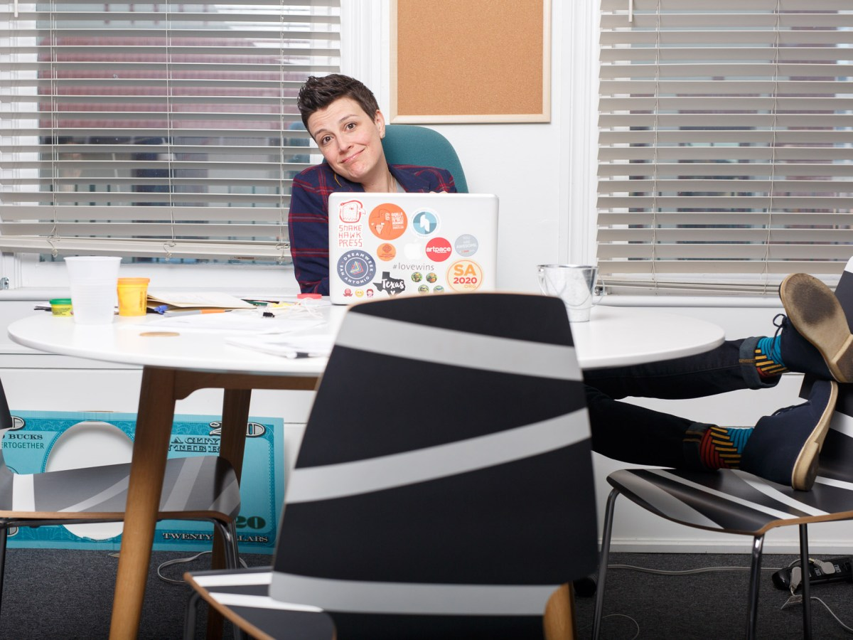 SA2020 President and CEO Molly Cox at a desk in the SA2020 offices at St. Paul Square.