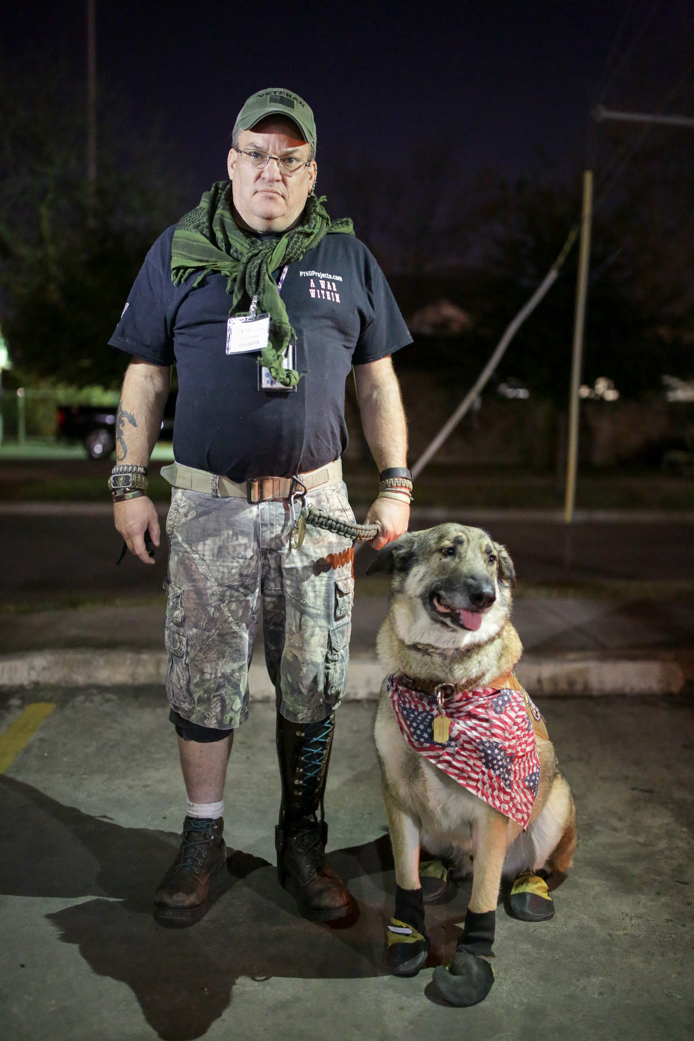 Tommy Riester and his service dog Cooper stand for a portrait near a homeless hot spot. Tommy has overcome homelessness and has been off the street for just over a year.