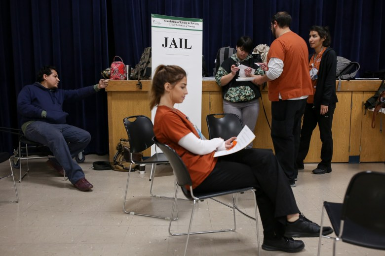 Students sit in jail as Braulio Amazaga (left), who portrayed a thief, points to a victim of his recent crime.