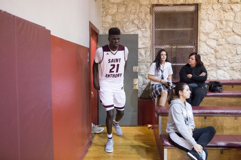 7-foot junior Ousmane Ndim exits the locker room in preparation FOR the second half in St. Anthony's game against KIPP on Monday, Jan. 23.