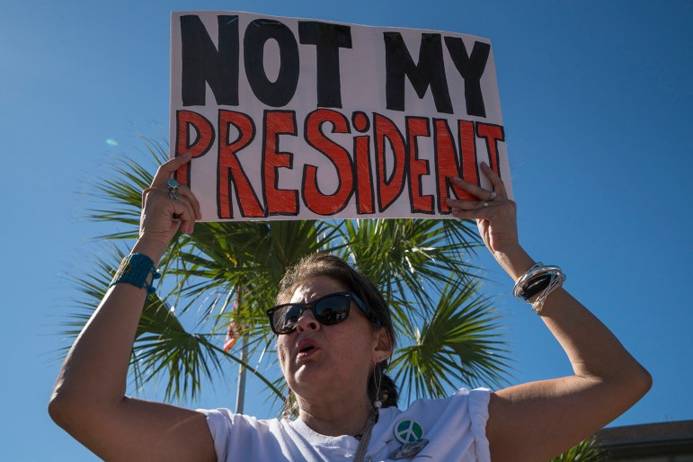 """Linda Roland, 56, hold a sign in protest of President Donald Trump during the Womens March in Brownsville, Texas. """"I cannot support a sexual preditor and misongynist,"""" Roland said."""
