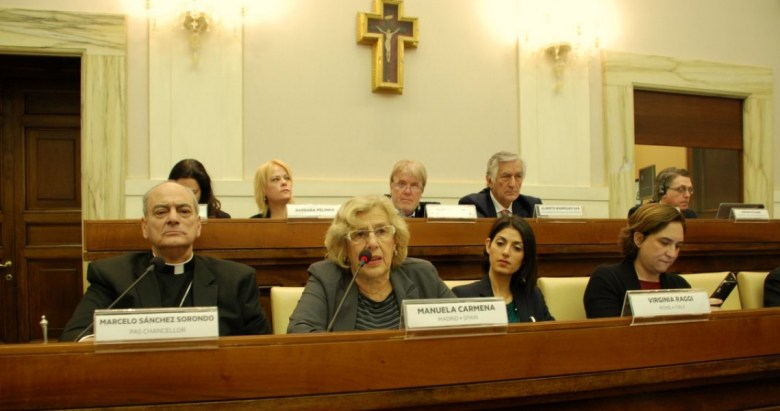 European mayors met at the Vatican last month to discuss local solutions to the refugee crisis. Bishop Marcelo Sánchez Sorondo, chancellor of the Vatican's Pontifical Academy of Sciences (left), organized the meeting. Madrid Mayor Manuela Carmena, Rome Mayor Virginia Raggi and Barcelona Mayor Ada Colau sat to his left.