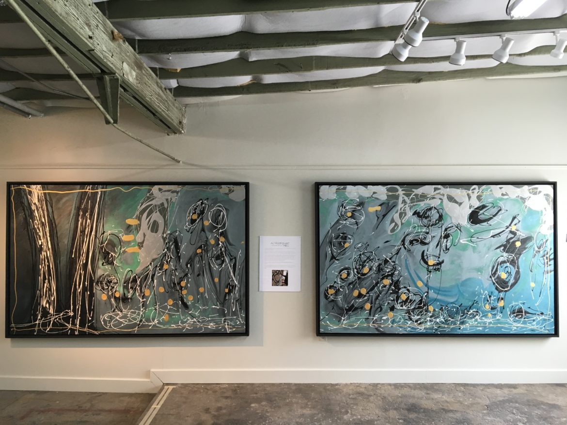 The paintings (from left) 'Sol' and 'Luna' from artist AJ Rodriguez will also be on display Friday, the 13th.