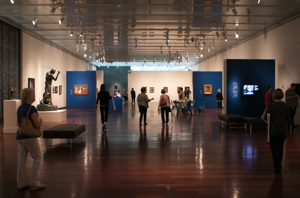 """Crowds of people wander through the exhibit """"Monet to Matisse: A Century of French Moderns"""" at the McNay Art Museum."""