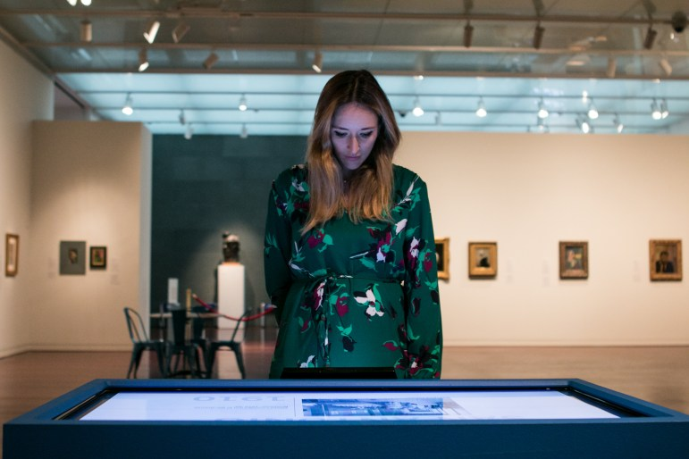 McNay Director of Communications and Marketing Daniela Oliver explores a digital timeline that compares happenings in San Antonio with those in Paris.