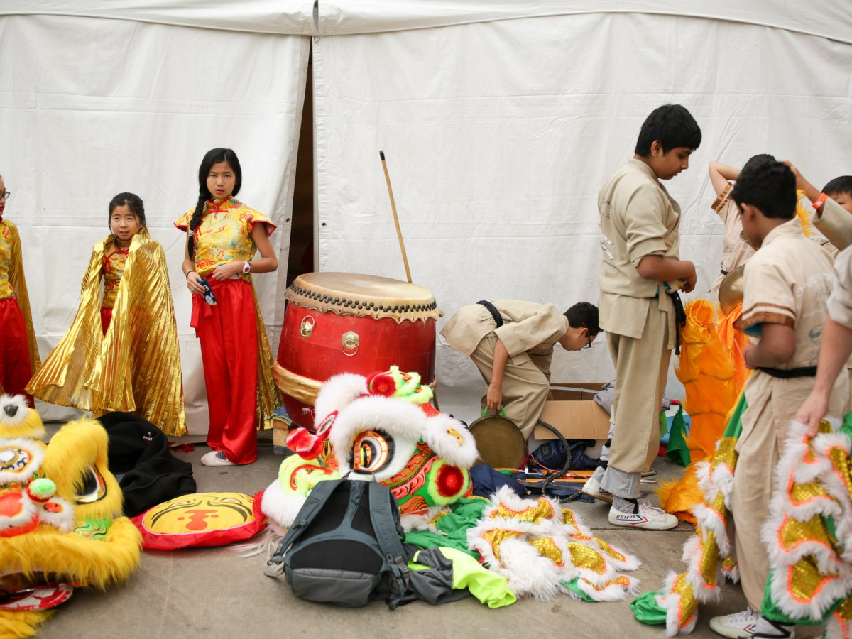Performers of the Confucius Institute of UTSA prepare for the stage.