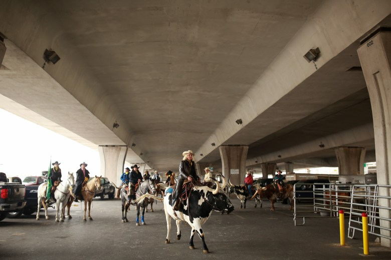 Western Heritage Parade participants prepare for the ride through downtown San Antonio.