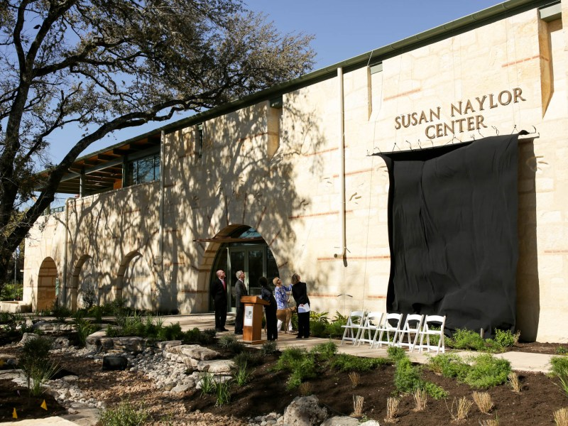 The curtain is released on the unveiling of the Susan Naylor Center.