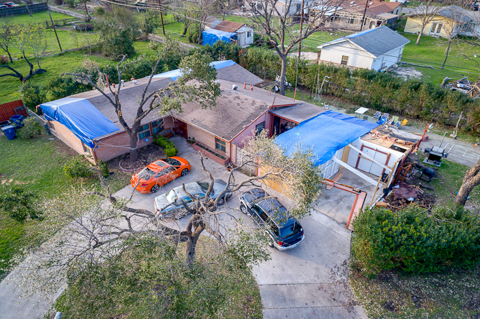 An aerial drone shot of Clem Spalding's home after the February 2017 tornado shows blue tarps he used to cover up parts of his missing roof and garage.