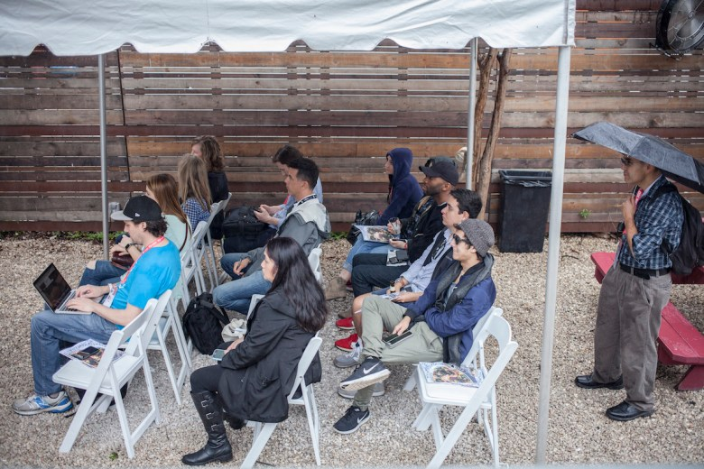 "Festival goers attend New York Times reporter David Philipps's presentation ""Staying Human in the Age of Digital Reporting"" at the SXSW ChooseSA event, on Saturday, March 11, 2017 at the Half Step Bar, in Austin."