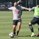 San Antonio FC midfielder Rafa Castillo (left) guards the ball from a team member during practice.