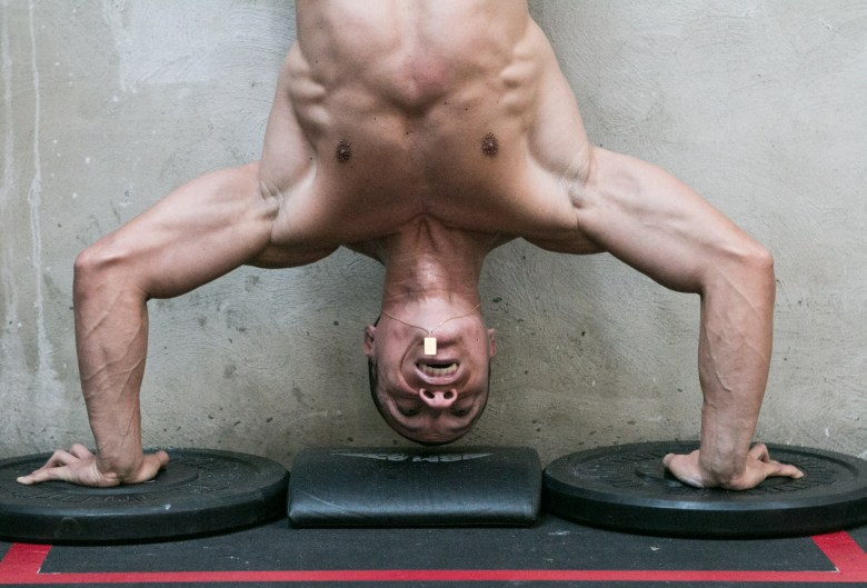 Lufe Torres completes his hand stand pushups during the opening stage of the CrossFit Games.