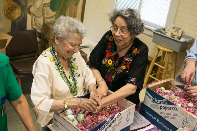 June Moore (left) and Angelica Teneyuca share a laugh while making cascarones.