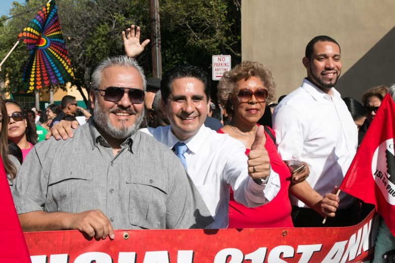 Board of Education Commissioner Ruben Cortez, Jr., Mayoral Candidate Manuel Medina, ______, and Bexar County Commissioner Tommy Calvert smile before marching in the Official 21st Anniversary Cesar E. Chavez March For Justice.