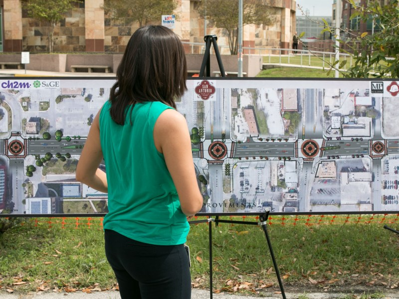 Senior Public Information Officer for Transportation and Capital Improvement Flor Salas sets up the visual display at the groundbreaking of the 2012 bond project for Frio Street.