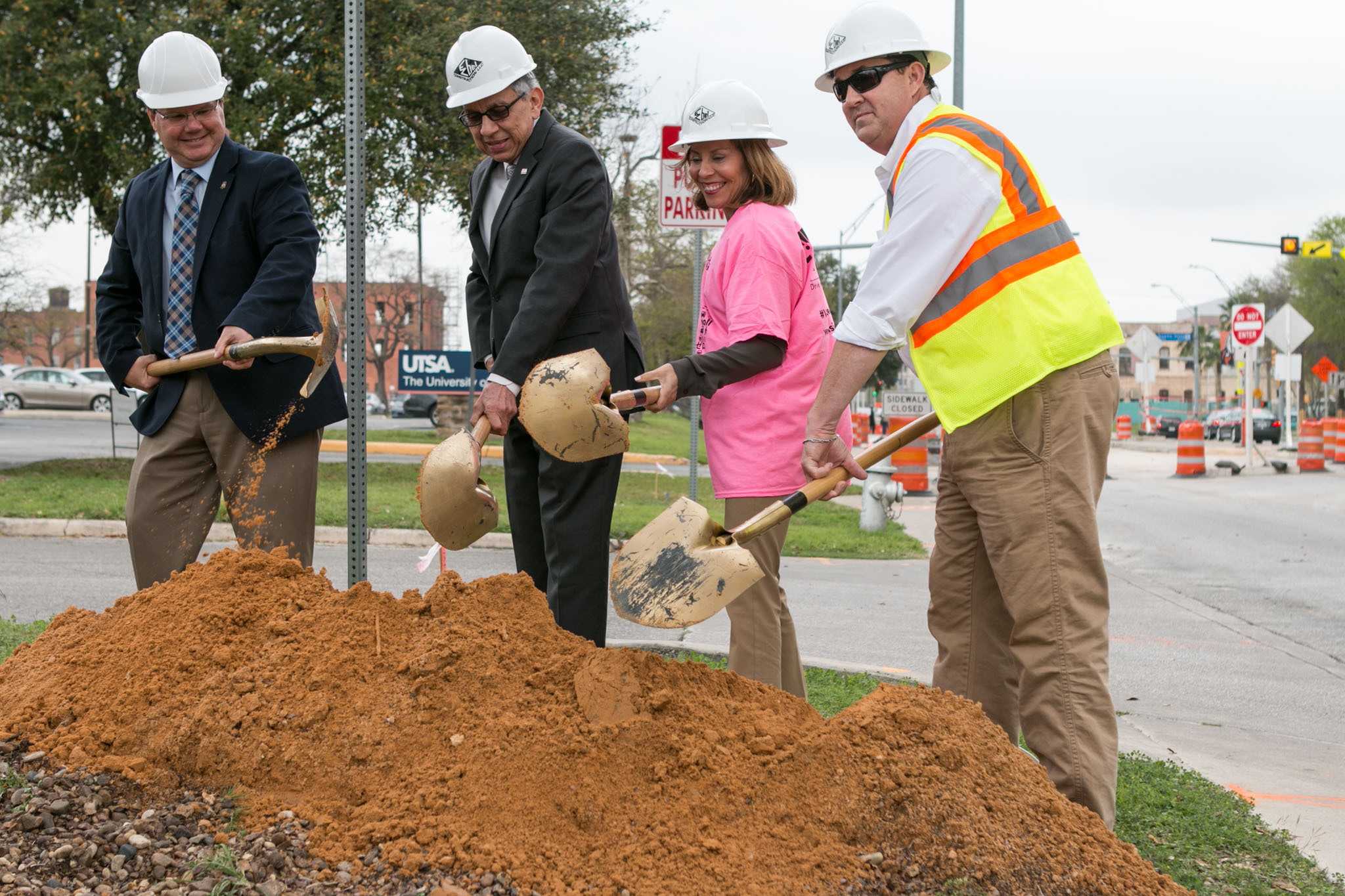 From left, Department of Transportation and Capital Improvements Capital Project Manager David McBeth, UTSA's Vice President for Community Services Jude Valdez, City Councilwoman of District 5 Shirley Gonzales, and E-Z Bel Construction Project Manager Brandon Bishop break the ground on the 2012 bond project for Frio Street.