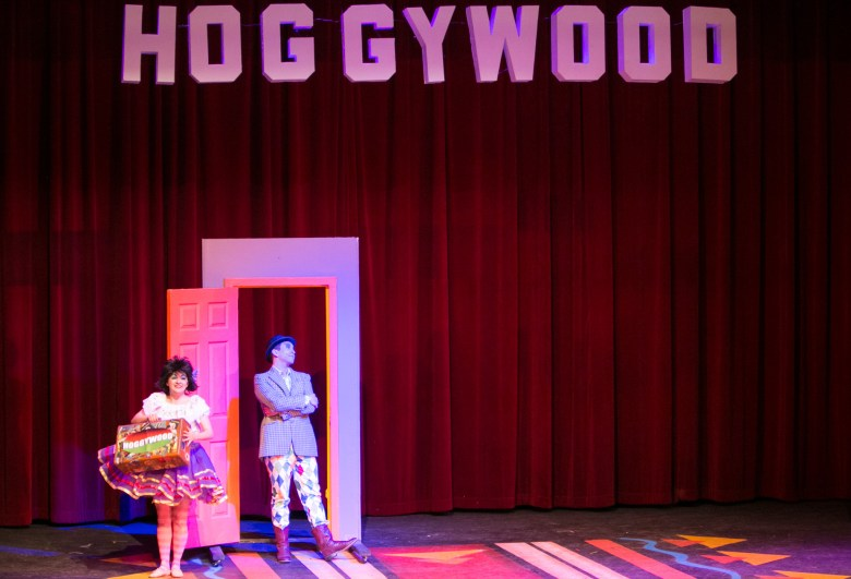 """(From left) Magik Theatre actress Jovi Lee asks actor Louie Canales for a job in Hoggywood in the sensory-friendly performance of """"The Three Javelinas."""""""