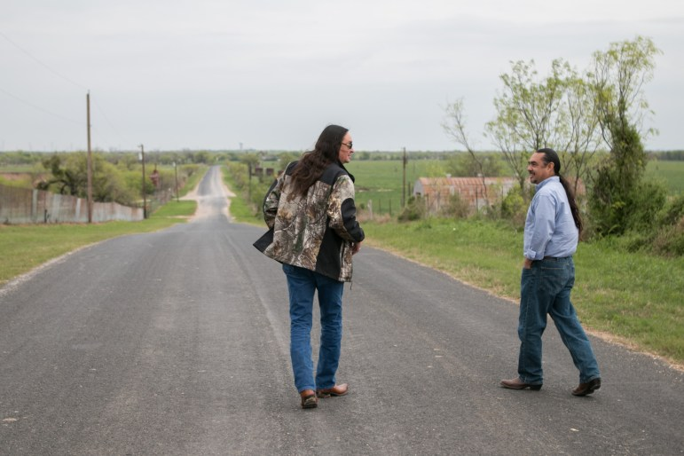 From left, professor at Northwest Vista College Rudy de la Garza and Executive Director of AITSCM Ramon Vasquez share stories while walking down the road next to the Enoch Jones House.