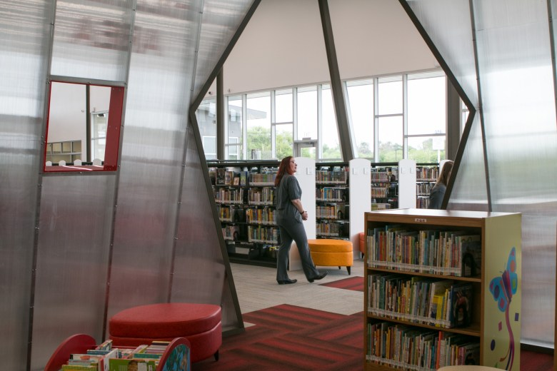 "Employees of the Schaefer Branch Library walk past ""Soar,"" the children's space."