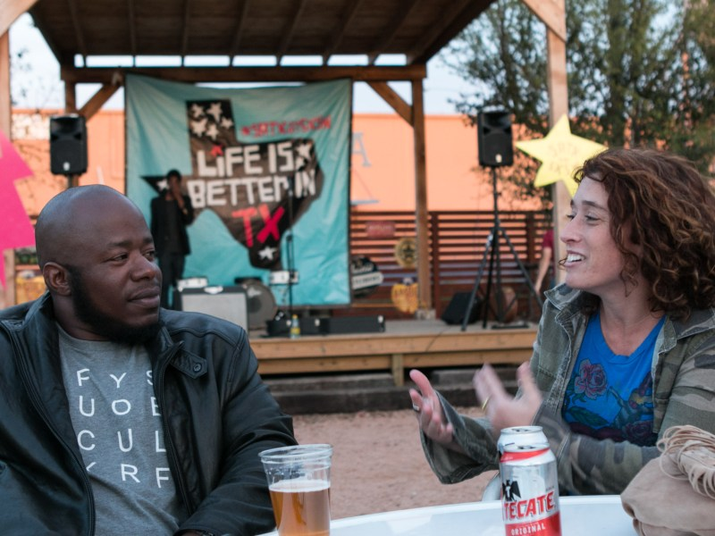 From left, Jay Jackson and Lisa Piriano enjoy a beer before the program begins at Burleson Yard Beer Garden at the SATX at SXSW Launch Party on March 1.