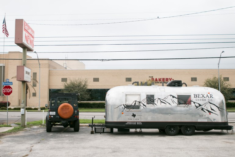 The Bexar Goods Company streamline trailer is located in a parking lot at 2202 Broadway Street.
