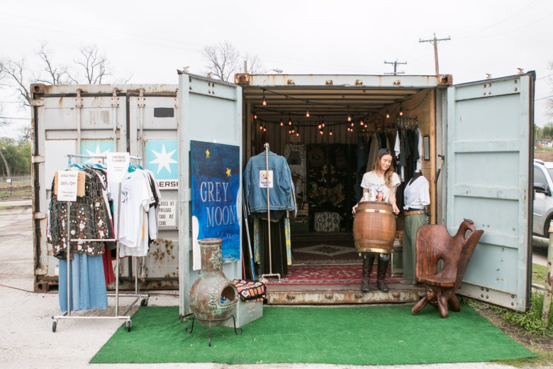 Co-owner of Grey Moon Vintage Natalie Medina opens up the company's storage container retail space located in a parking lot at 2202 Broadway Street.