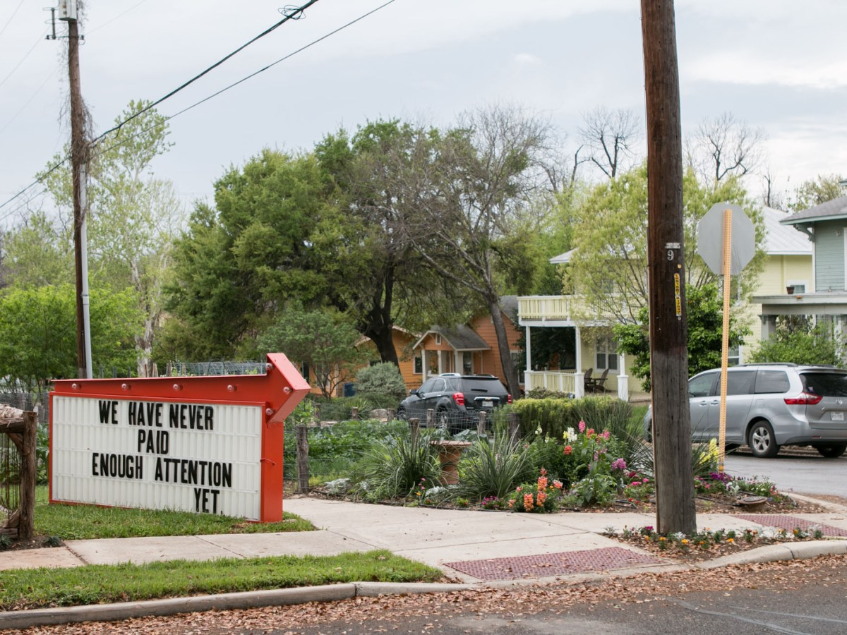A sign created for the Word Around Town public art project is displayed at 2919 N. Flores St.