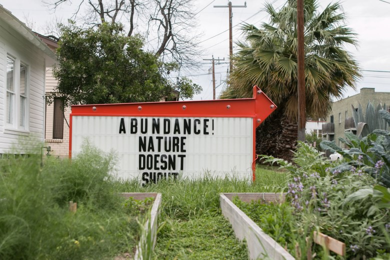 A sign created for the Word Around Town public art project is displayed at 3301 N. Flores St.