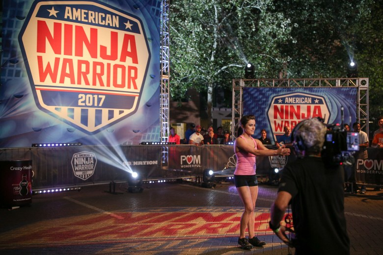Ninja Warrior veteran Kacy Catanzaro warms up before her run on the obstacle course.