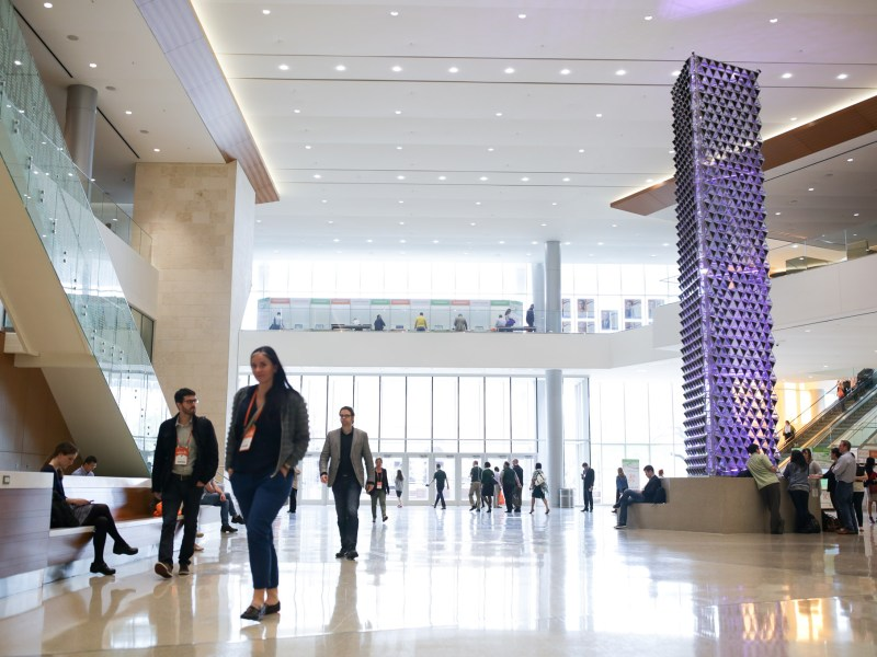 Liquid Crystal, by London-based artist Jason Bruges, stands tall in the Convention Center lobby.