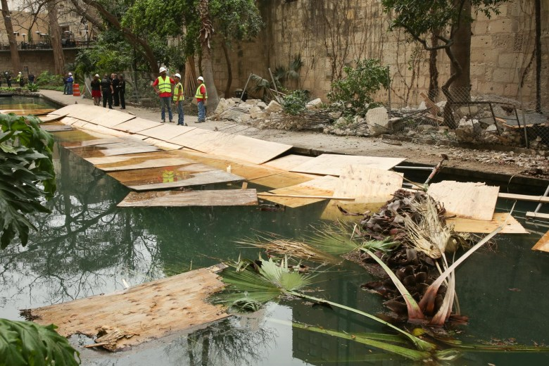 Debris from the Solo Serve construction site fell into the San Antonio River.