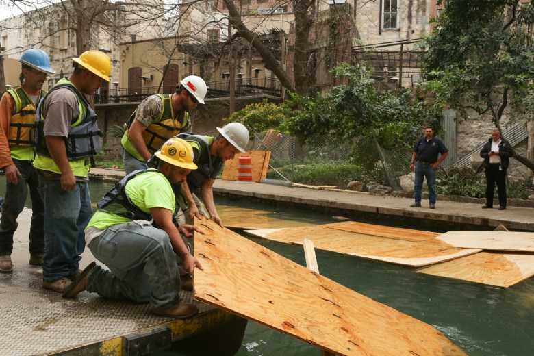 Crews remove debris from the San Antonio River.