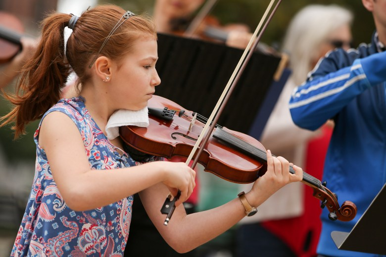 Adriana, 10, performs Bach with fellow musicians including members of the San Antonio Symphony at Main Plaza.