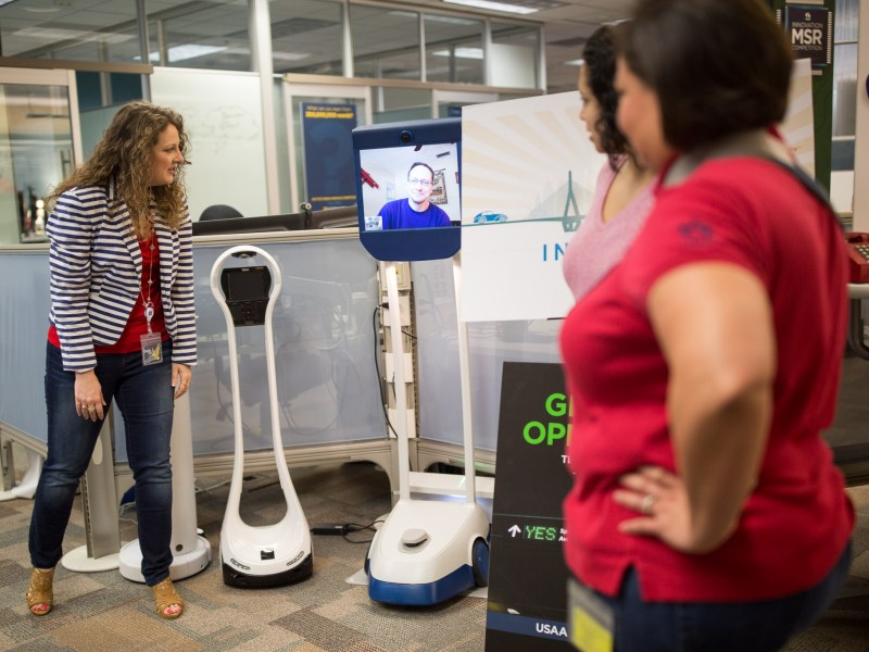 USAA Executive Director of Employee Innovation Janelle Dziuk talks with an employee across the country on a Skype-equipped laptop on a Beam model robot.