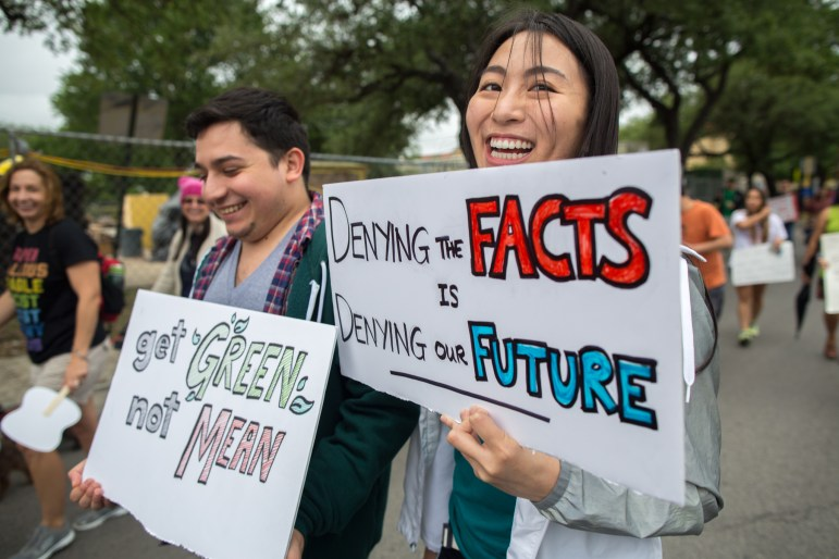 Anvy Vu, 23, a first year epidemiology grad student at UT Health Science Center marches down main street.