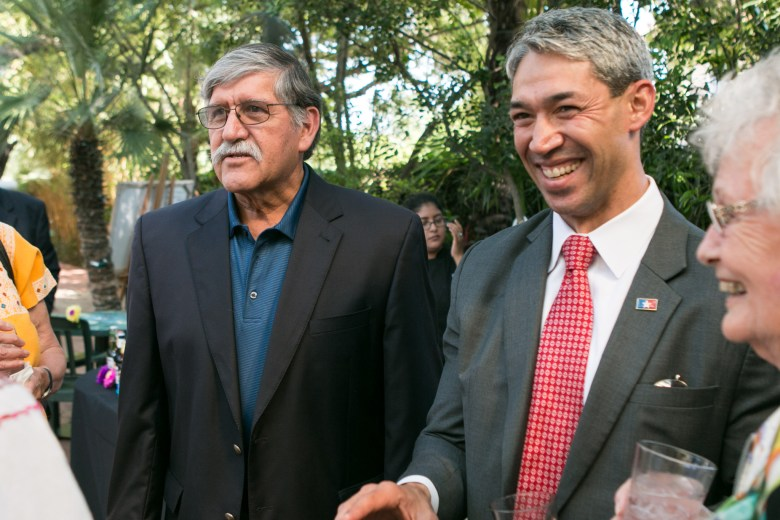 (From left) Former UTSA President Ricardo Romo, Councilman Ron Nirenberg (D8), and Betty Sotherland smile while sharing memories of the late Alicia Guadiana.