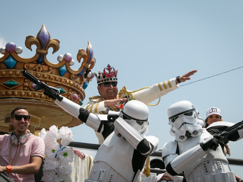 Rey Feo LXIX Fred Reyes dances with storm troopers on his float during the Battle of Flowers Parade.