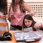 Emma, 11, plays scrabble at the Barbank High School Scrabble Club tent at the San Antonio Book Festival.