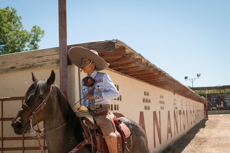 A charro prepares his horse for A Day in Old Mexico & Charreada.