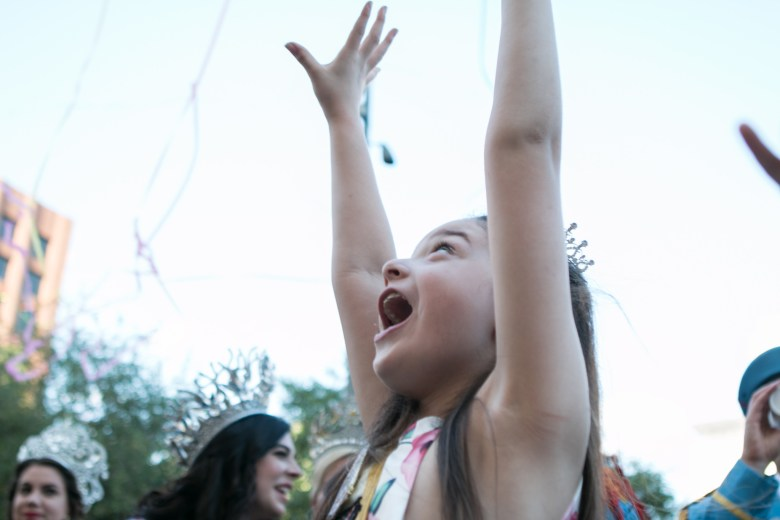 El 69th Rey Feo Fred Reyes's daughter Peyton, 7, screams at the confetti exploding in the air after her father is crowned.