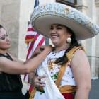 (From left) San Antonio Charro Irma Rodriguez and San Antonio Charro Queen Yazmin Bernal prepare for the crowning of El 69th Rey Feo Fred Reyes.
