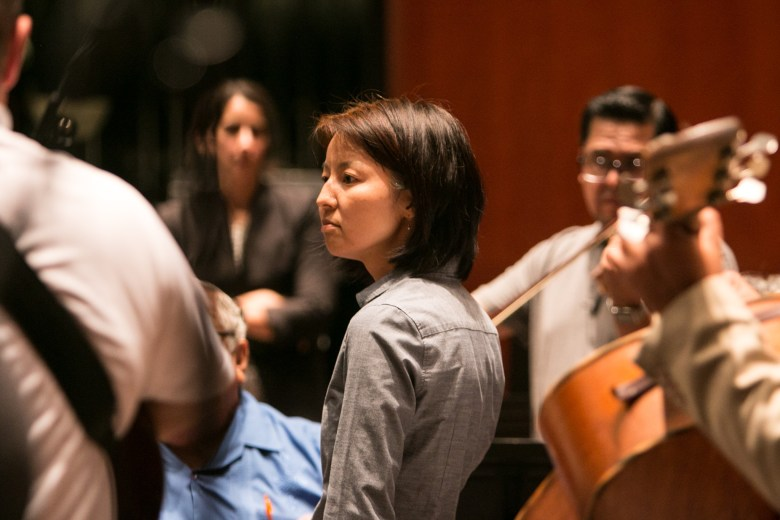 Conductor Akiko Fujimoto watches practice for the Fiesta Pops concert in the Tobin Center for the Performing Arts.