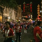A marching band walks in the Fiesta Flambeau Parade.